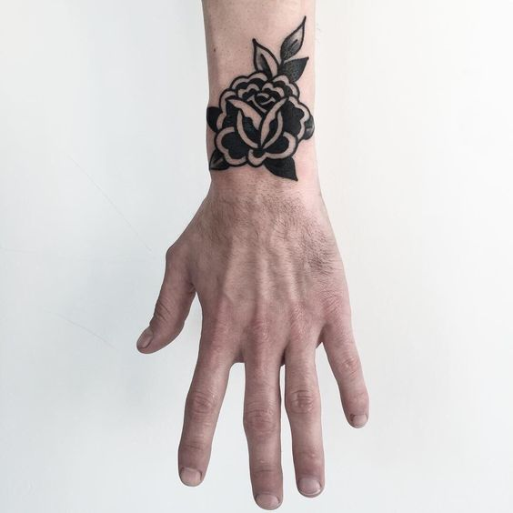 Black rose tattoo on the wrist