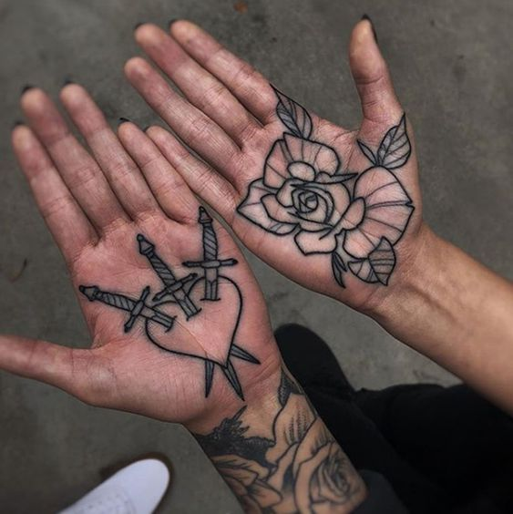 Black tattoos on both palms