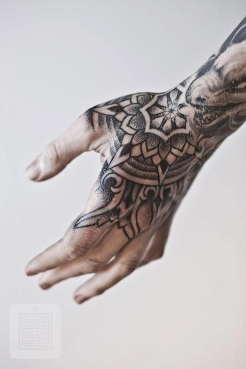Blackwork mandala hand tattoo idea