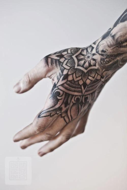 Blackwork mandala hand tattoo idea