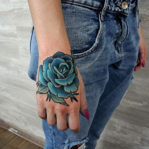 Blue rose tattoo on the right hand for the women
