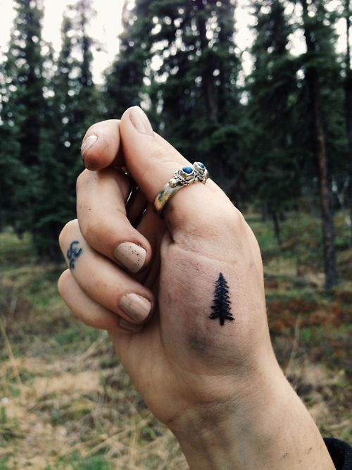 Christmas tree tattoo on the hand