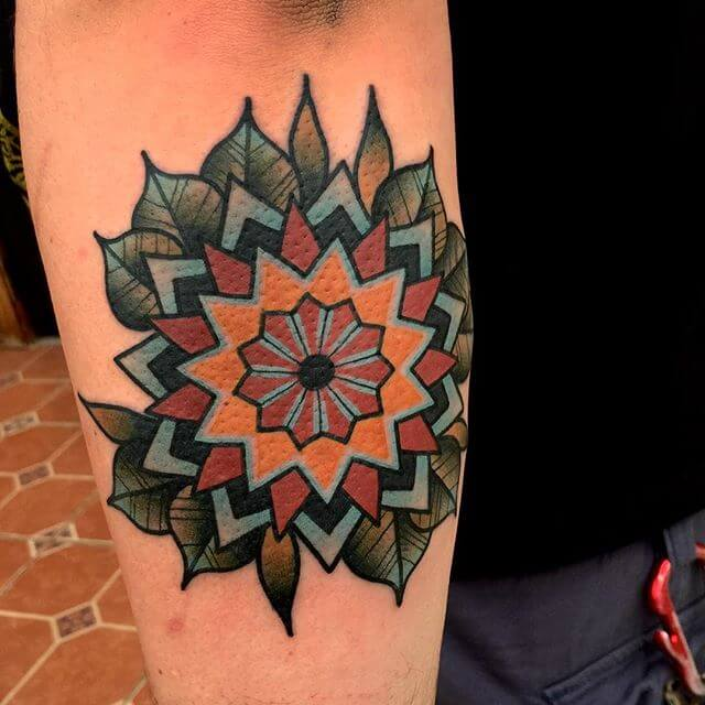 Colorful mandala tattoo on the arm