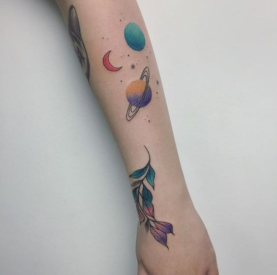 Colorful space tattoo on the arm