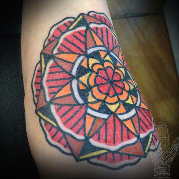 Colorful traditional style mandala tattoo
