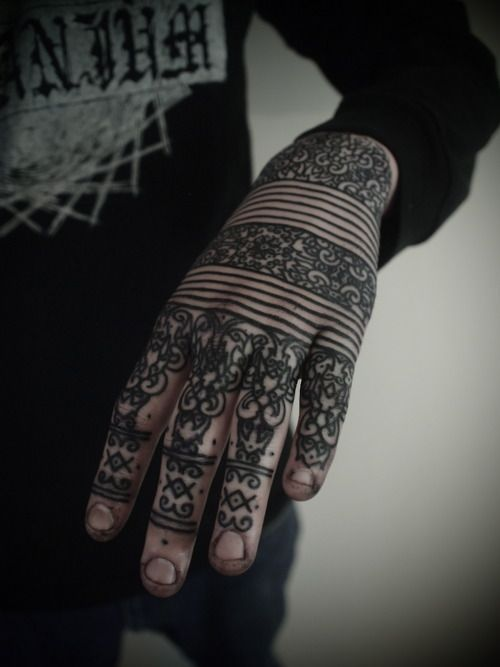 Cool blackwork hand tattoo idea