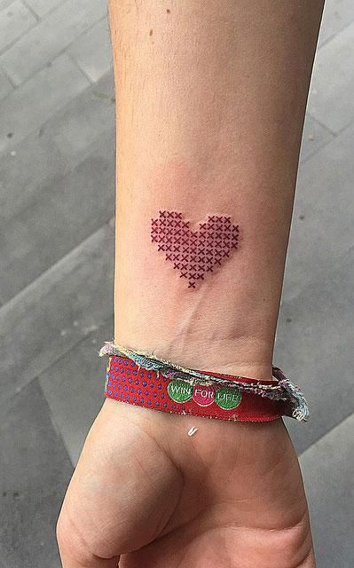 Cross-stitch heart tattoo on wrist