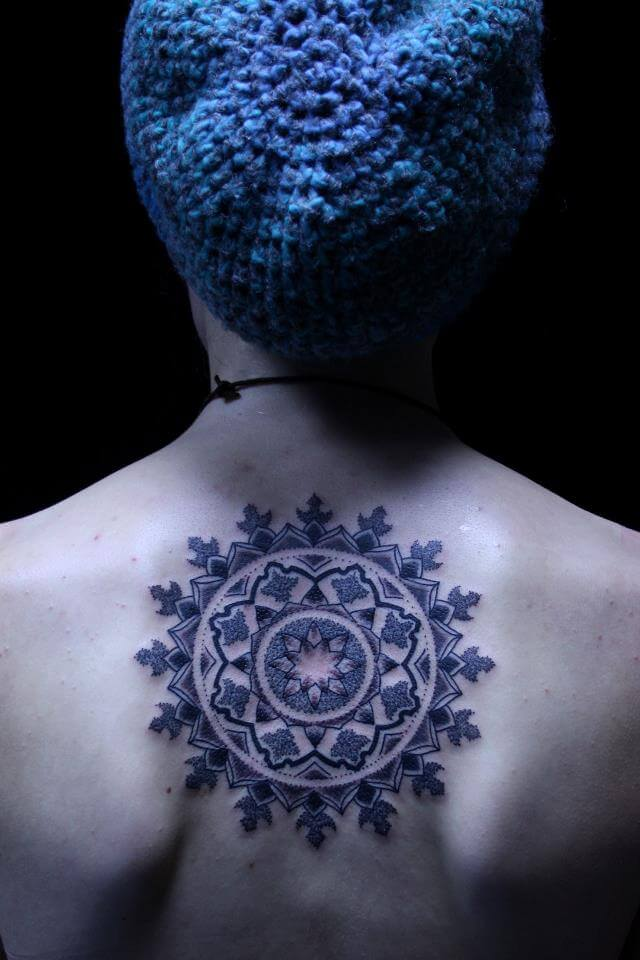 Dotwork mandala tattoo on the upper back