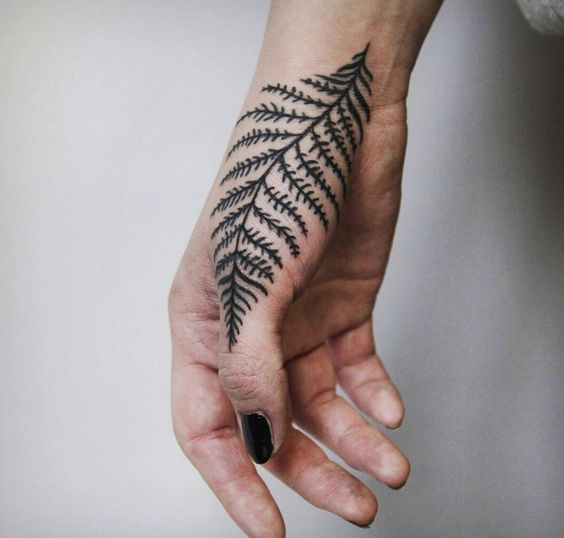 Fern leaf tattoo on the hand