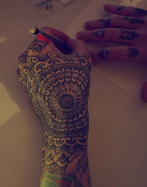 Fine detailing on this perfect mandala tattoo on the hand