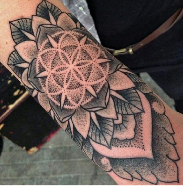 Floral mandala tattoo on the forearm
