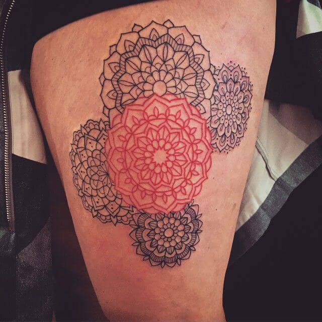 Four black and one red mandala tattoo