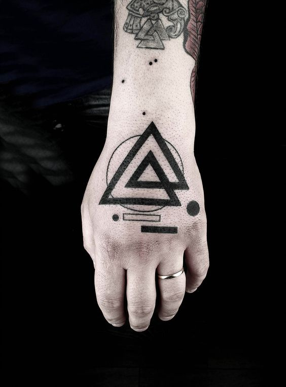 Geometric shapes hand tattoo by tattooist Okan Uckun