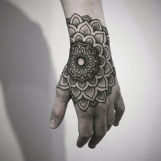Gorgeous dotwork mandala tattoo on the hand