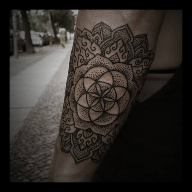 Gorgeous sacred geometry and mandala tattoo combined