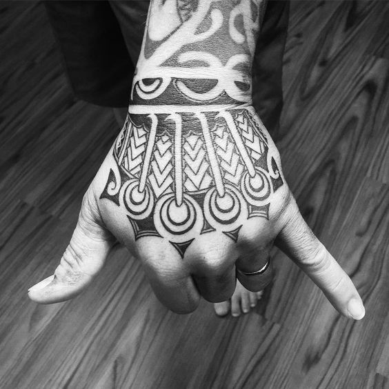 Hawaiian tattoo design on the hand