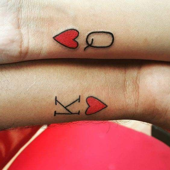 King and queen heart tattoo on wrists for couples