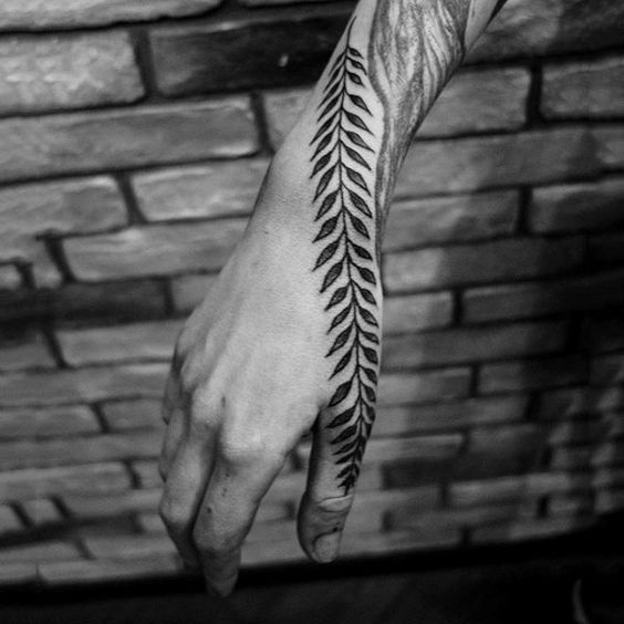 Leaf vine tattoo on the hand