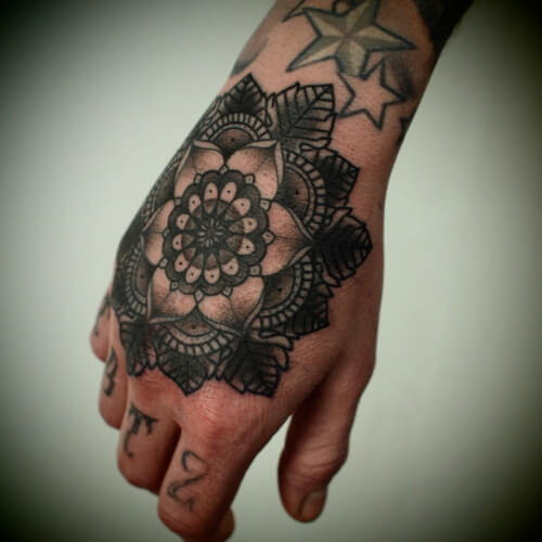 Mandala tattoo design on the arm for the guys