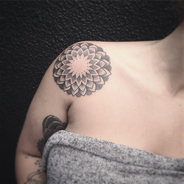 Middle size mandala tattoo on the shoulder