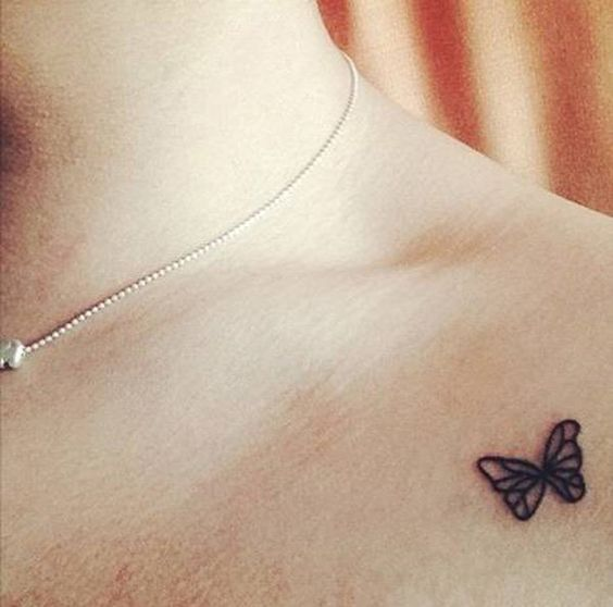 Minimal butterfly tattoo on the clavicle