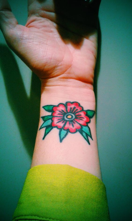 Old school flower tattoo on the wrist made by Anna Sandberg