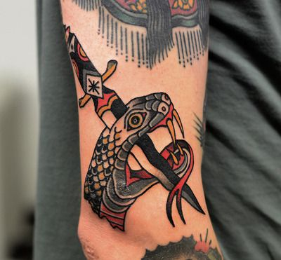 Old school snake and dagger tattoo