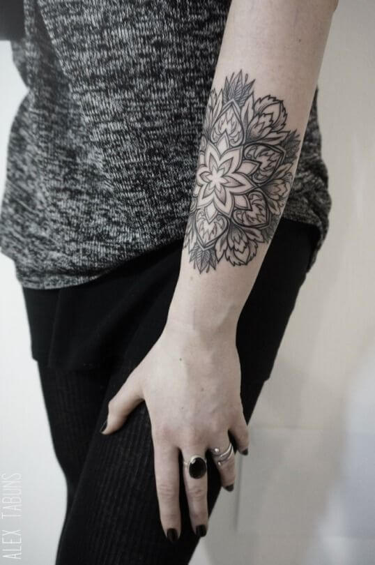 Perfect mandala tattoo on the arm for women