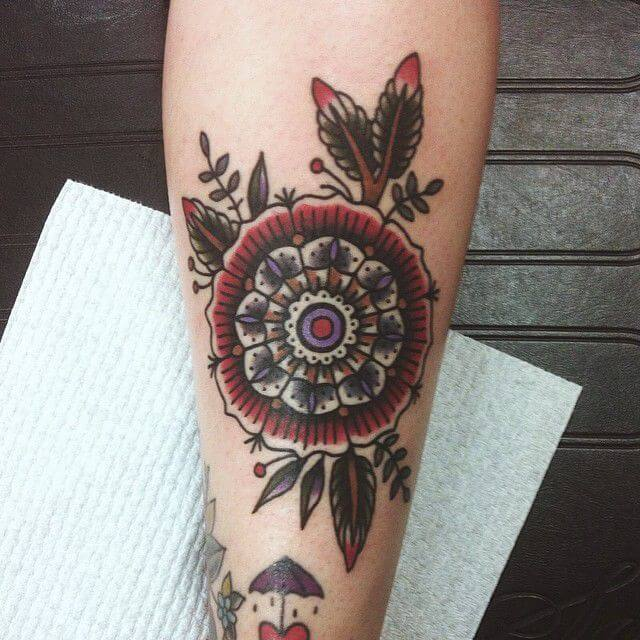 Red and black traditional style mandala tattoo