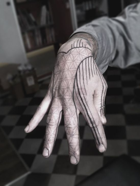 Sacred geometry and black lines tattoo on the hand
