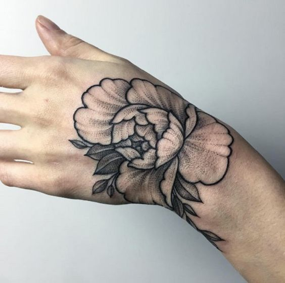Shaded peony hand tattoo idea
