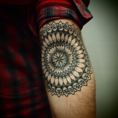 Simple black mandala tattoo on the inner arm
