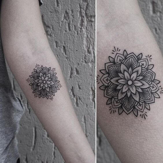 Small flower mandala tattoo on the arm