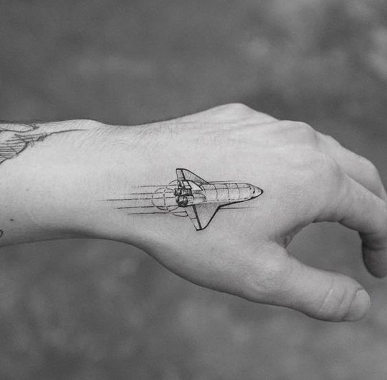 Small spaceship tattoo on the hand