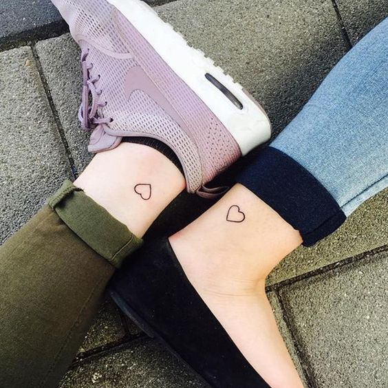 Tattoo idea for sisters - matching small heart tattoo on the ankle