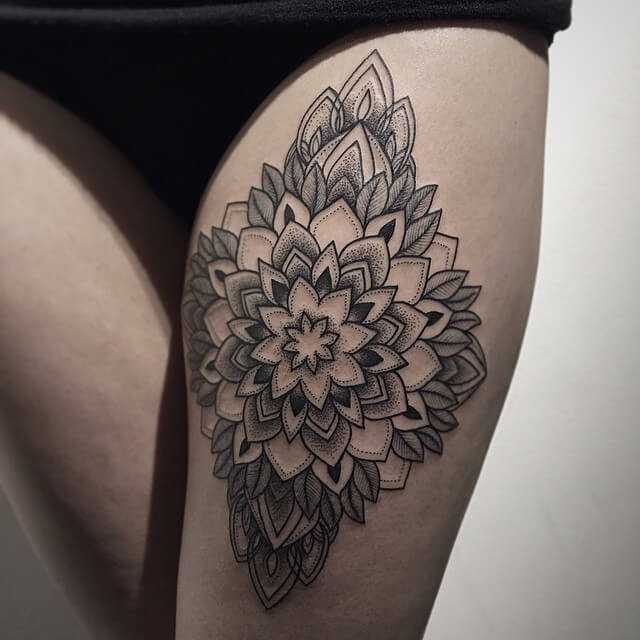 Thigh is a beautiful place for a bigger mandala tattoo