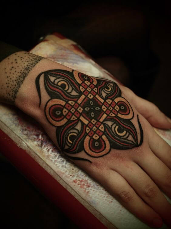 Traditional coloring mandala tattoo on the hand
