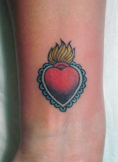 Traditional heart tattoo on the wrist