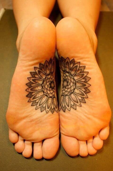Two halfs of mandala tattoos on both feet