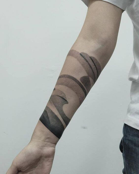 Black abstract dotwork tattoo on the right arm
