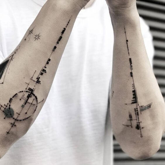Black abstract tattoos on forearms