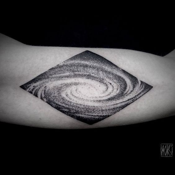 Black spiral galaxy tattoo