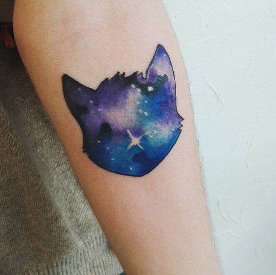 Cat head tattoo filled with galaxy background