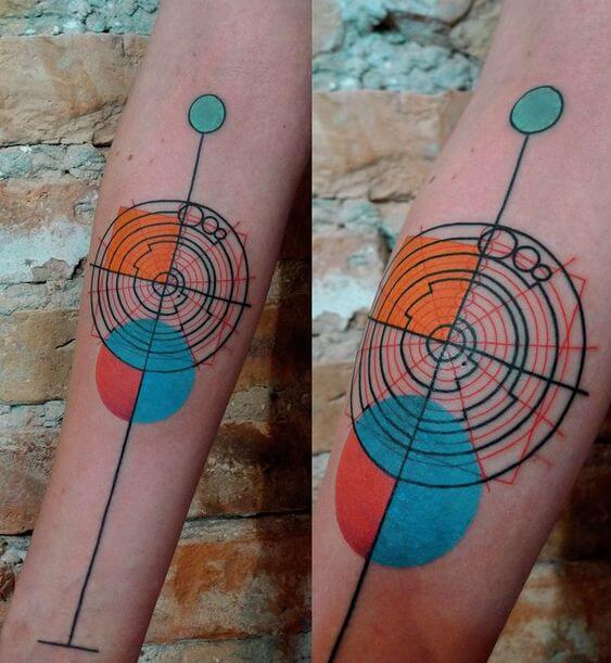 Circles and lines tattoo on the inner arm