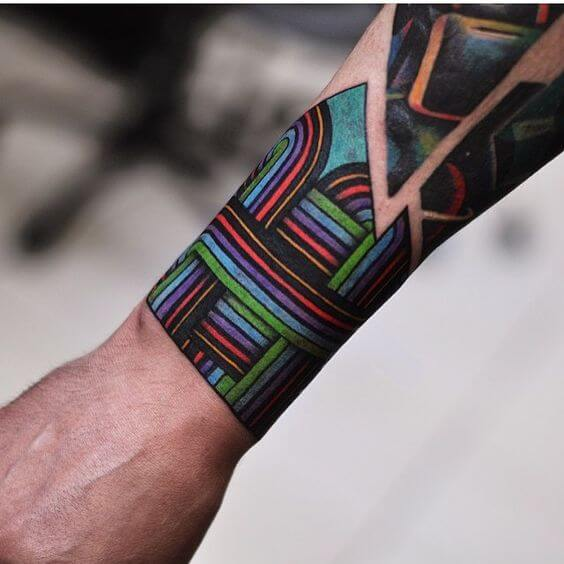 Colorful lines abstract tattoo on arm