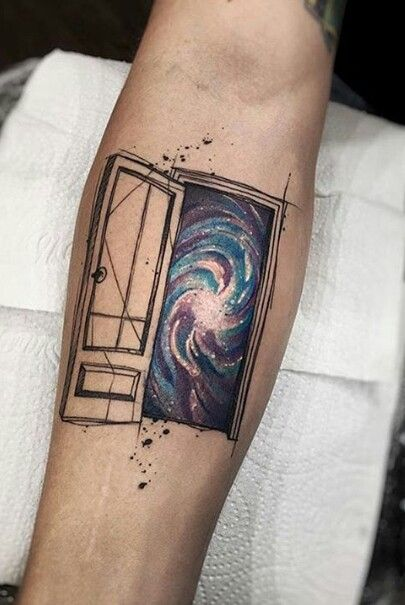 Door tattoo with spiral galaxy inside