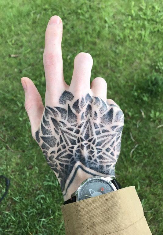 Dotwork mandala tattoo on the right hand