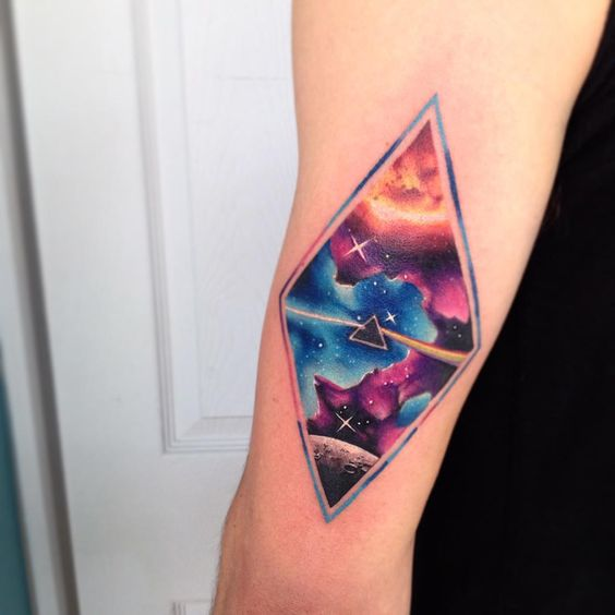 Rhombus tattoo with galaxy scenery and Pink Floyd logo by Adrian Bascur