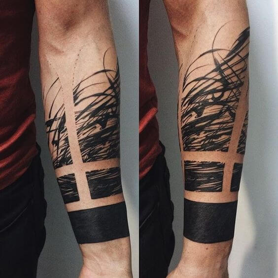 Solid black abstract tattoo on the arm
