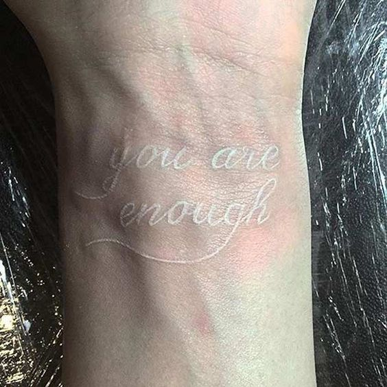 You are enough white quote wrist tattoo